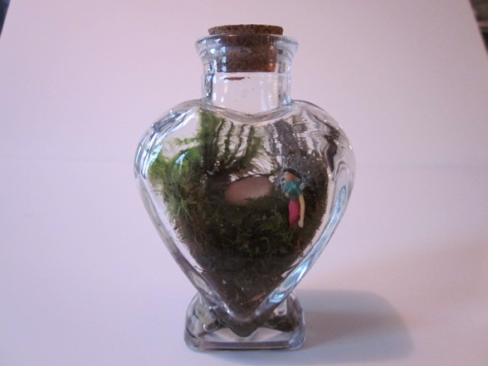 Woman in heart terrarium.